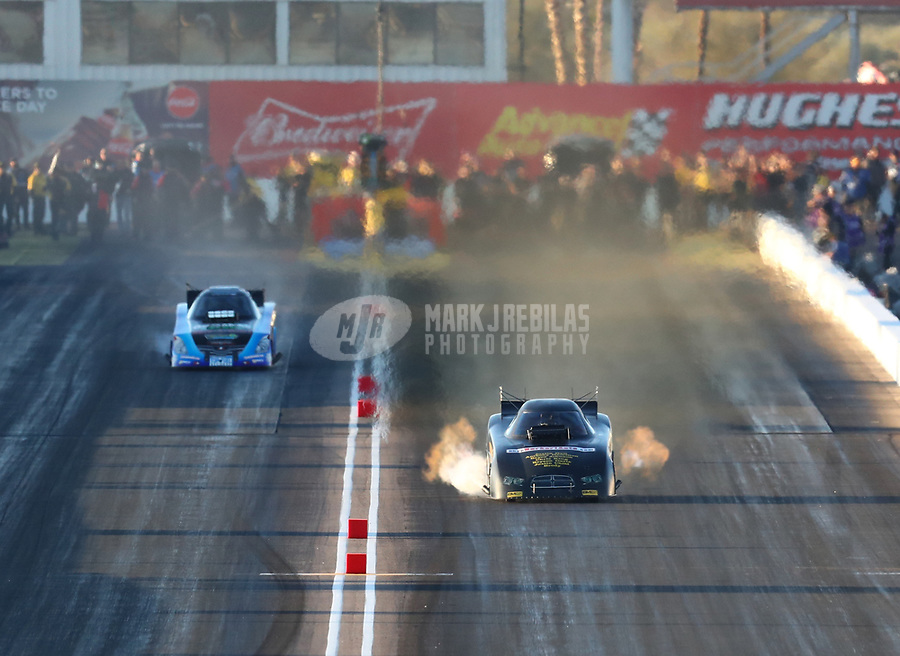 Feb 23, 2019; Chandler, AZ, USA; NHRA funny car driver Phil Burkhart (right) alongside Jeff Diehl during qualifying for the Arizona Nationals at Wild Horse Pass Motorsports Park. Mandatory Credit: Mark J. Rebilas-USA TODAY Sports