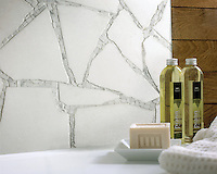 Path custom bathroom mosaic backsplash in Thassos, and Calacatta Tia honed