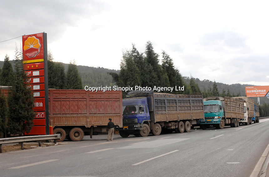Truckers wait in line for a rationing of diesel at a Sinopec station in Kunming, China . Each truck is allowed only 200 RMB (less than 40 liters) of diesel at this particular station. There is a fuel shortage in China and the state have intervened to stabilize the crisis. Recently Chinese Premier Wen Jiabao said there should be no immediate increase of oil product prices..