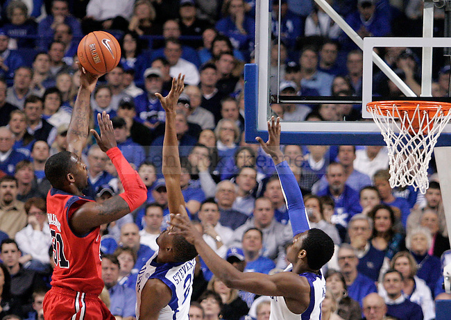 University of Kentucky senior forward Perry Stevenson and freshman guard John Wall try to block a shot by Ole Miss guard Murphy Holloway in UK's 85-75 win over Ole Miss on Tuesday, Feb. 2, 2010 in Rupp Arena...Photo by Ed Matthews | Staff