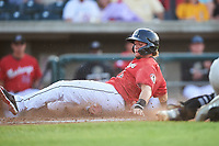 Billings Mustangs Valentin Martinez (46) slides safely across home plate during a Pioneer League game against the Grand Junction Rockies at Dehler Park on August 15, 2019 in Billings, Montana. Billings defeated Grand Junction 11-2. (Zachary Lucy/Four Seam Images)