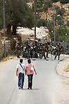 A pair of young Palestinians approach an IDF road block in Beit Jala, near bethlehem, on Sunday May 16th 2010. The IDF designated the area a closed military zone following a demonstration in which eight activists were arrested. The girl was subsequently allowed to pass to her home on the other side of the road block.