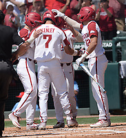 NWA Democrat-Gazette/ANDY SHUPE<br /> Arkansas second baseman Jack Kinley (7) is congratulated at the plate Saturday, June 8, 2019, by shortstop Casey Martin, center fielder Dominic Fletcher and catcher Casey Opitz after hitting a 3-run home run during the first inning in the NCAA Super Regional game at Baum-Walker Stadium in Fayetteville. Visit nwadg.com/photos to see more photographs from the game.