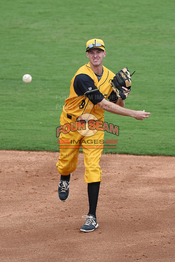 Jacksonville Suns  shortstop Danny Black (18) warmup throw to first during a game against the Pensacola Blue Wahoos on April 20, 2014 at Bragan Field in Jacksonville, Florida.  Jacksonville defeated Pensacola 5-4.  (Mike Janes/Four Seam Images)
