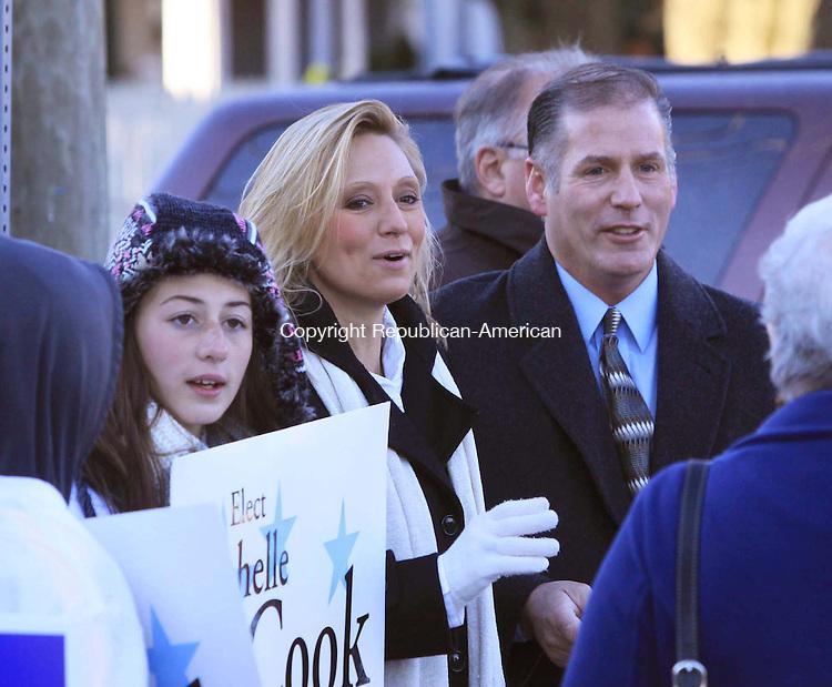 TORRINGTON, CT - 6 November 2012 - 110612JM01 - State Rep. Michelle Cook, D-Torrington, her husband, Chris, and their daughter, Ashlynn, greet voters outside the Torrington Armory on Tuesday. John McKenna Photo