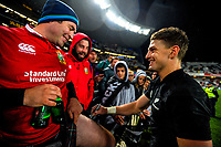 Beauden Barrett signs a fan's leg after the 2017 DHL Lions Series rugby union match between the NZ All Blacks and British & Irish Lions at Eden Park in Auckland, New Zealand on Saturday, 24 June 2017. Photo: Dave Lintott / lintottphoto.co.nz