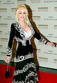 Washington, D.C. - December 2, 2006 -- Dolly Parton arrives for the State Department Dinner for the 29th Kennedy Center Honors dinner at the Department of State in Washington, D.C. on Saturday evening, December 2, 2006.  Andrew Lloyd Webber, Zubin Mehta, Dolly Parton, Smokey Robinson and Stephen Spielberg are being honored in 2006 for their contribution to American culture..Credit: Ron Sachs / CNP