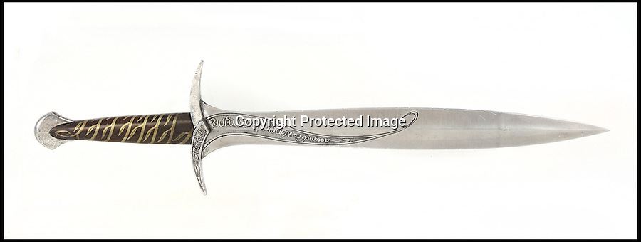 BNPS.co.uk (01202) 558833<br /> Picture: Julien's/BNPS<br /> <br /> ****Please use full byline****<br /> <br /> Frodo's sword expected to fetch &pound;93,750. <br /> <br /> Lord of the bling...<br /> <br /> Hobbit hero Frodo Baggins' ring and sword are among an incredible &pound;1.5 million archive of props from the blockbuster Lord of the Rings films that has emerged for sale.<br /> <br /> Dozens of the smash hit trilogy's most iconic costumes and props are up for grabs including Gandalf's staff, Sauron's helmet and Gimli's battle axe.<br /> <br /> Fans of the films, adapted from the 1954 book by British author J.R.R. Tolkein, can also get their hands on prosthetic hobbit ears and feet.<br /> <br /> Amazingly the props have been compiled by a Lord of the Rings enthusiast who has spent more than 10 years scouring the world for authentic memorabilia.<br /> <br /> They are being sold by Julien's Auctions in Los Angeles on December 5.