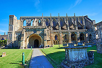 The south side of the 12the century early transitional Norman architecture of the parish church of St Peter & St Paul part of Malmesbury Abbey, Wiltshire, England