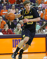 Nov 30, 2010; Clemson, SC, USA; Michigan Wolverines forward Evan Smotrycz (23) dribbles around defenders in the game against the Clemson Tigers at Littlejohn Coliseum. Mandatory Credit: Daniel Shirey/WM Photo -US PRESSWIRE