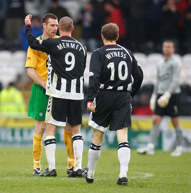 Stephen McManus dejected as he leaves the pitch with goalscorer Billy Mehmet