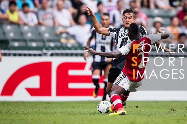 Juventus' player Paulo Dybala contests the ball against South China's player Agbo Wisdom Fofo during the South China vs Juventus match of the AET International Challenge Cup on 30 July 2016 at Hong Kong Stadium, in Hong Kong, China.  Photo by Marcio Machado / Power Sport Images