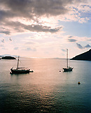 GREECE, Patmos, Grikos, Dodecanese Island, boats anchored in Grikos Bay at sundown, the Agean Sea