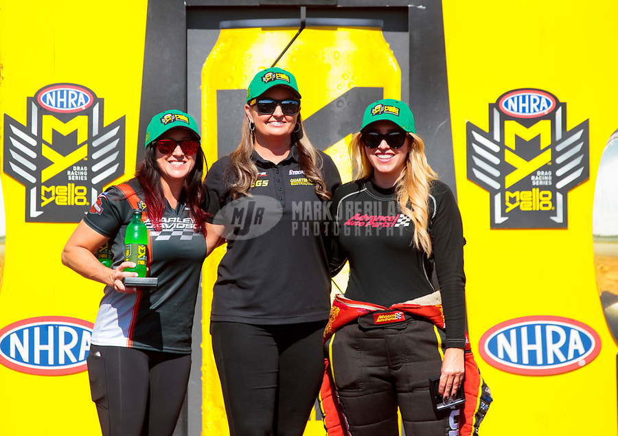 Sep 15, 2019; Mohnton, PA, USA; NHRA pro stock motorcycle rider Angelle Sampey (left), pro stock driver Erica Enders (center) and top fuel driver Brittany Force pose for a photo as the first time three female professional drivers have qualified number one for their classes during the Reading Nationals at Maple Grove Raceway. Mandatory Credit: Mark J. Rebilas-USA TODAY Sports