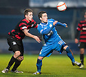 Queen of the South's Nicky Clark gets away from Ayr Utd's Kyle McAusland.