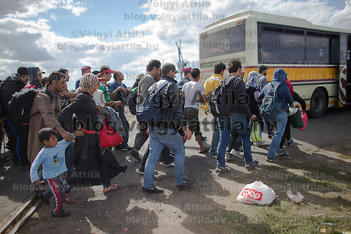 Illegal migrants get on a bus to be taken for registration after they crossed the border between Hungary and Serbia near Roszke (about 174 km South of capital city Budapest), Hungary on September 07, 2015. ATTILA VOLGYI