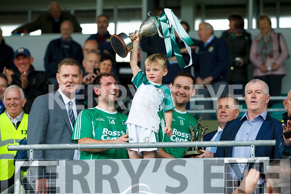 Ballyduff Captain Mikey Boyle and his son Bobby and Liam Boyle man of the MatchBallyduff with the cup after the Senior County Hurling Final in Austin Stack Park on Sunday