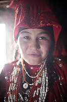 Portrait of Ooroon Bu, shortly before getting married with Nimat Ullah (son of Abdul Walli)..In and around the camp of Manara (Sufi camp), near the borders with China and Tajikistan...Trekking with yak caravan through the Little Pamir where the Afghan Kyrgyz community live all year, on the borders of China, Tajikistan and Pakistan.