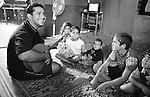 Shatila, the &quot;gipsy camp&quot;. A &quot;oud&quot; (oriental lute) player entertains a few kids from the camp. The dewellings, made of corrugated iron, scrap wood and plastic sheets, are clean inside.<br />  <br /> Chatila, Camp des &laquo;Nouriy&eacute;&raquo; (Tsiganes). Un joueur de &laquo;Oud&raquo; (luth oriental) donne un concert gratuit &agrave; quelques enfants du camp. Les habitations faits de t&ocirc;le ondul&eacute;e, bouts de bois et b&acirc;ches en plastique sont propres &agrave; l'int&eacute;rieur.