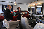 Nuha Abdul Haq, right, and a salesman, left, at a Peugeot car dealer in Ramallah, West Bank.<br />
