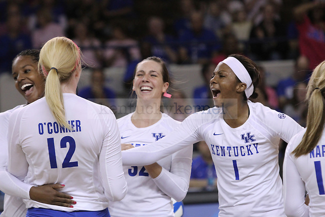 The University of Kentucky volleyball team celebrates a point during the University of Kentucky vs. Texas A&M volleyball match at Memorial Coliseum in Lexington, Ky., on Sunday, October 14, 2012. Photo by Jared Glover | Staff