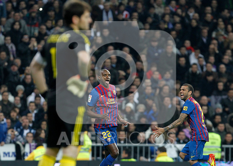 FC Barcelona's Eric Abidal (c) and Daniel Alves (r) celebrate goal in presence of Real Madrid's Iker Casillas delected (l) during Spanish King's Cup match.January 18,2011. (ALTERPHOTOS/Acero)
