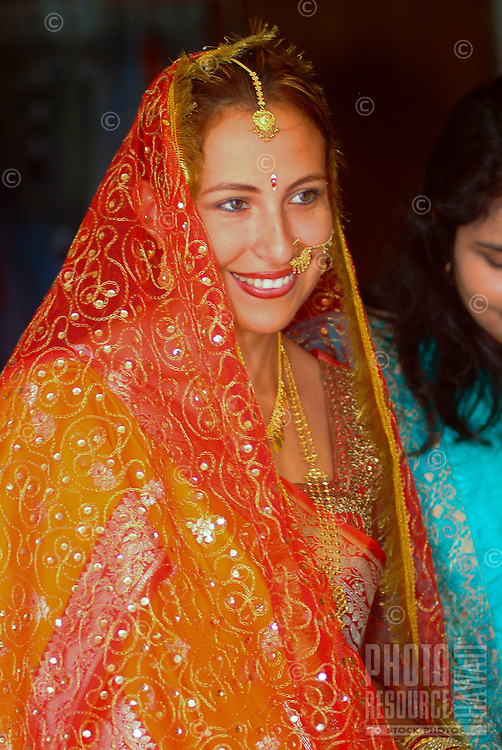 Tradditional Hindi wedding with bride with indian adornments about to meet her groom
