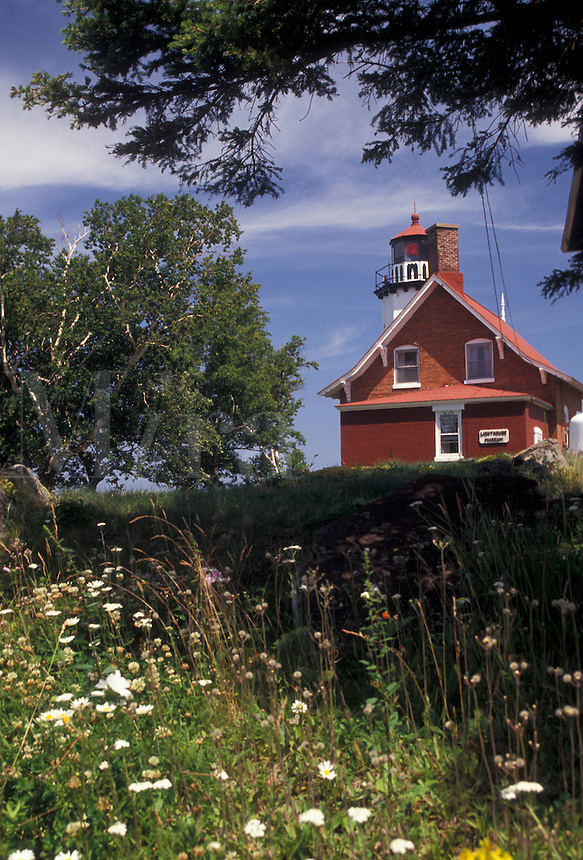 AJ2846, lighthouse, Upper Peninsula, U.P., Michigan, Scenic view of the Lighthouse at Eagle Harbor perched up on a hill of wildflowers in the state of Michigan.