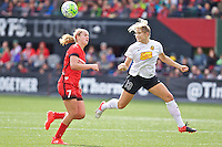 Portland, Oregon - Sunday October 2, 2016: Western New York Flash defender Abigail Dahlkemper (13) heads th ball away from Portland Thorns FC midfielder Lindsey Horan (7) during a semi final match of the National Women's Soccer League (NWSL) at Providence Park.