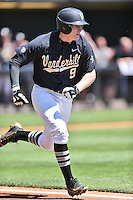 Vanderbilt Commodores third baseman Will Toffey (9) runs to first during a game agains against the Tennessee Volunteers at Lindsey Nelson Stadium on April 24, 2016 in Knoxville, Tennessee. The Volunteers defeated the Commodores 5-3. (Tony Farlow/Four Seam Images)