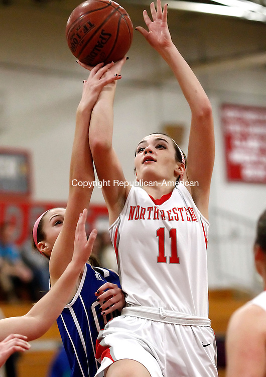 Winsted, CT- 05 January 2015-010515CM07 Northwestern's Emma Beltrandi takes to the ball up for two as Lewis Mills' Alyssa Wrabel defends during their Berkshire League matchup in Winsted on Monday.   Christopher Massa Republican-American