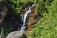 A hiker gazes at Bear Creek Falls near Telluride, Colorado.