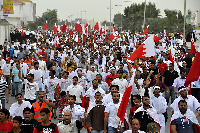 Tens of thousands of Bahraini anti-government protesters converged from two directions Saturday, March 12, 2011, to demonstrate outside the walls of King Hamad bin Isa Al Khalifa's Safriya palace in Sadad, Bahrain, southwest of the capital of Manama. Several protesters demanding the fall of the Bahraini regime wore white burial shrouds to indicate their willingness to die. Photo by Ammar A.rasool