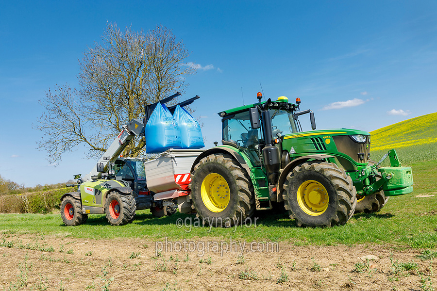 Loading bagged nitrogen into the fertilser spreader - Northamptonshire, April