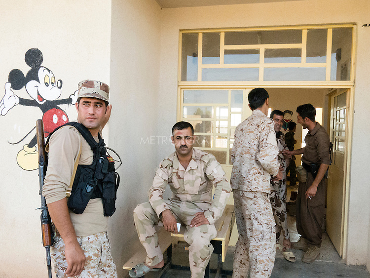 12/08/14  Iraq -- Daquq, Iraq -- Peshmerga stand at the entrance of Shalyar school, Daquq.