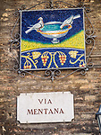 Birdbath mosaic and street sign: Via Mentana, Ravenna, Italy