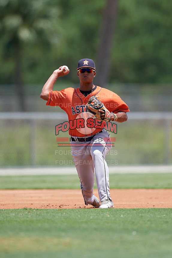 GCL Astros third baseman Rolando Espinosa (10) throws to first base during a Gulf Coast League game against the GCL Marlins on August 8, 2019 at the Roger Dean Chevrolet Stadium Complex in Jupiter, Florida.  GCL Marlins defeated GCL Astros 5-4.  (Mike Janes/Four Seam Images)