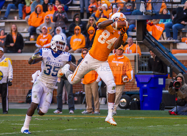 Tennessee's Cordarrelle Patterson catches a ball just beyond the Kentucky senior defender Cartier Rice in Knoxville, Tn., on Saturday, November, 24, 2012. Photo by James Holt | Staff