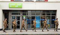 Men in World War I gear outside Job Centre Plus in the High Street, Swansea, south Wales UK. Friday 01 July 2016