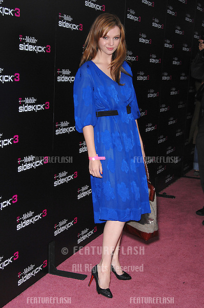 AMBER TAMBLYN at party in Beverly Hills to launch the new limited edition T-Mobile Sidekick 3 designs..October 12, 2006  Los Angeles, CA.Picture: Paul Smith / Featureflash
