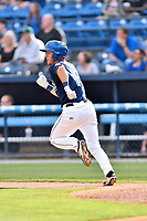 Asheville Tourists left fielder Ben Johnson (11) runs to first base during a game against the Rome Braves at McCormick Field on June 24, 2017 in Asheville, North Carolina. The Tourists defeated the Braves 6-5. (Tony Farlow/Four Seam Images)