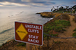 Stay Back Warning sign for unstable coastal cliffs at Sunset , San Diego, California