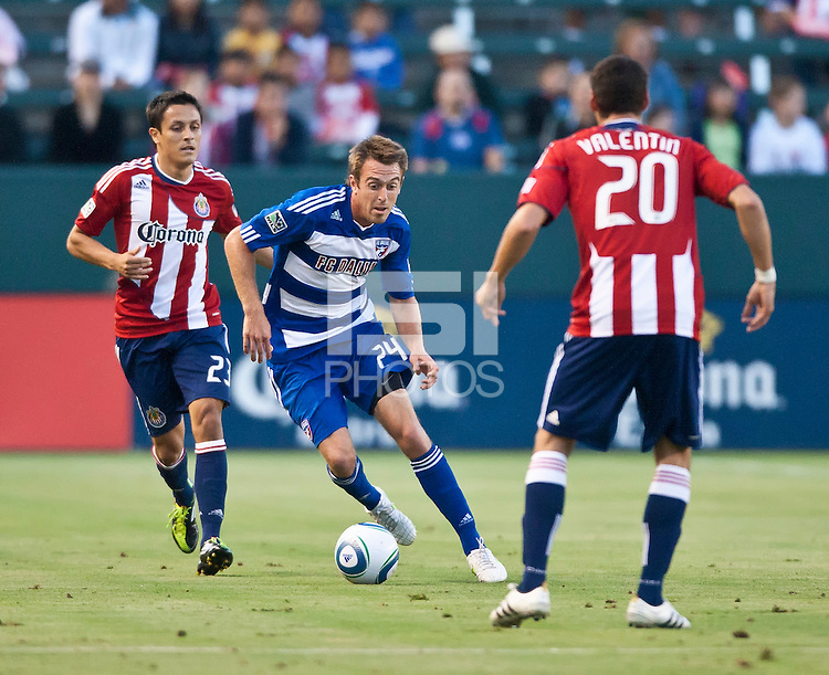 CARSON, CA – June 18, 2011: FC Dallas midfielder Eric Alexander (24) and Chivas USA forward Marcos Mondaini (23) during the match between Chivas USA and FC Dallas at the Home Depot Center in Carson, California. Final score Chivas USA 1, FC Dallas 2.