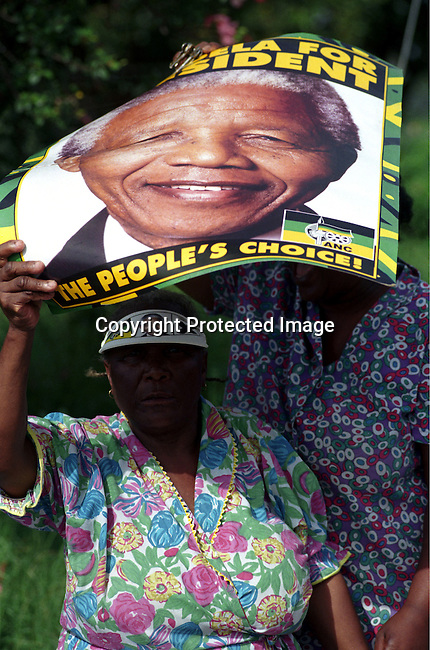 .An old woman ANC supporter waiting for Nelson Mandela, the former president of South Africa on April 21, 1994 at a pre-election rally in Durban days before the historic democratic election on April 27, 1994 in South Africa. Mr Mandela became the first black democratic elected president in South Africa. He retired from office after one term in June 1999. .Photo: Per-Anders Pettersson/ iAfrika Photos.