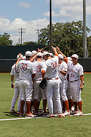 Texas Longhorns huddle before the NCAA Super Regional baseball game against the Houston Cougars on June 7, 2014 at UFCU Disch–Falk Field in Austin, Texas. The Longhorns are headed to the College World Series after they defeated the Cougars 4-0 in Game 2 of the NCAA Super Regional. (Andrew Woolley/Four Seam Images)