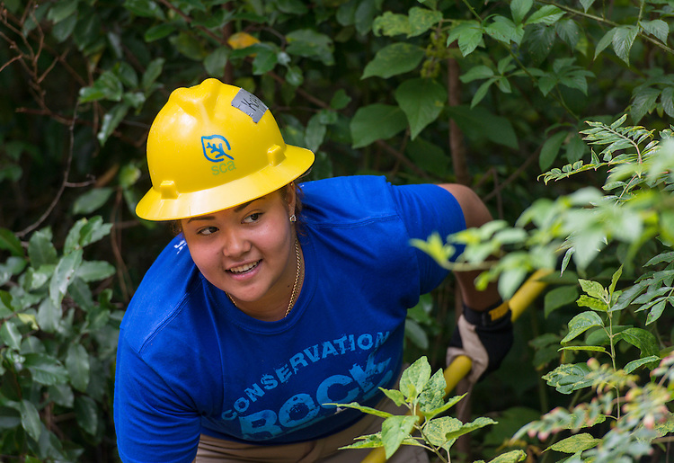 Milby High School senior Karina Sustaita works on a trail at the Houston Arboretum during the Student Conservation Association Houston (SCA) Summer Community Crew Program, July 21, 2014.