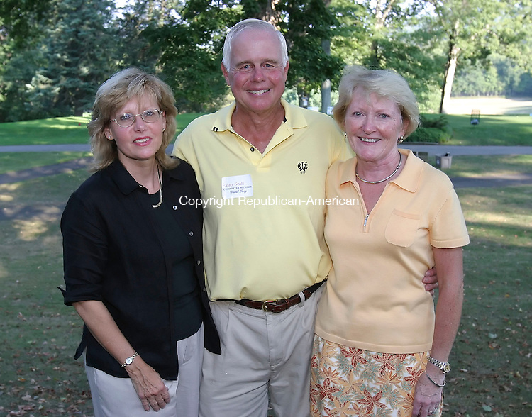 SOUTHBURY,  CT 12 September 2005 -091205BZ05-  From left-  Carolee Kalita, director of development for Easter Seals; David Long, of Watertown, a committee member; Laurin Traub (CQ), of Bethlehem, committee member;<br /> <br /> after the Easter Seals Harold Leever Golf Classic held at the Heritage Village Country Club Monday.<br />  Jamison C. Bazinet / Republican-American