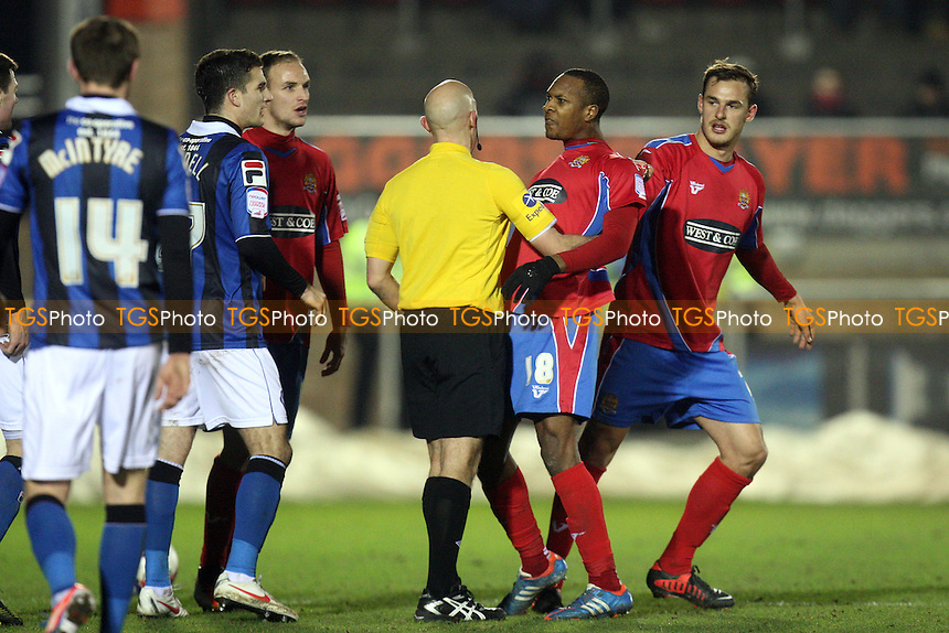 Gavin Hoyte of Dagenham is dragged away after being abused by Bobby Grant of Rochdale - Dagenham and Redbridge vs Rochdale at the London Borough of Barking and Dagenham Stadium - 12/01/13 - MANDATORY CREDIT: Dave Simpson/TGSPHOTO - Self billing applies where appropriate - 0845 094 6026 - contact@tgsphoto.co.uk - NO UNPAID USE.