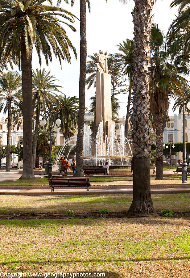 Fountain and palm trees in Plaza de Espana, Melilla autonomous city state Spanish territory in north Africa, Spain