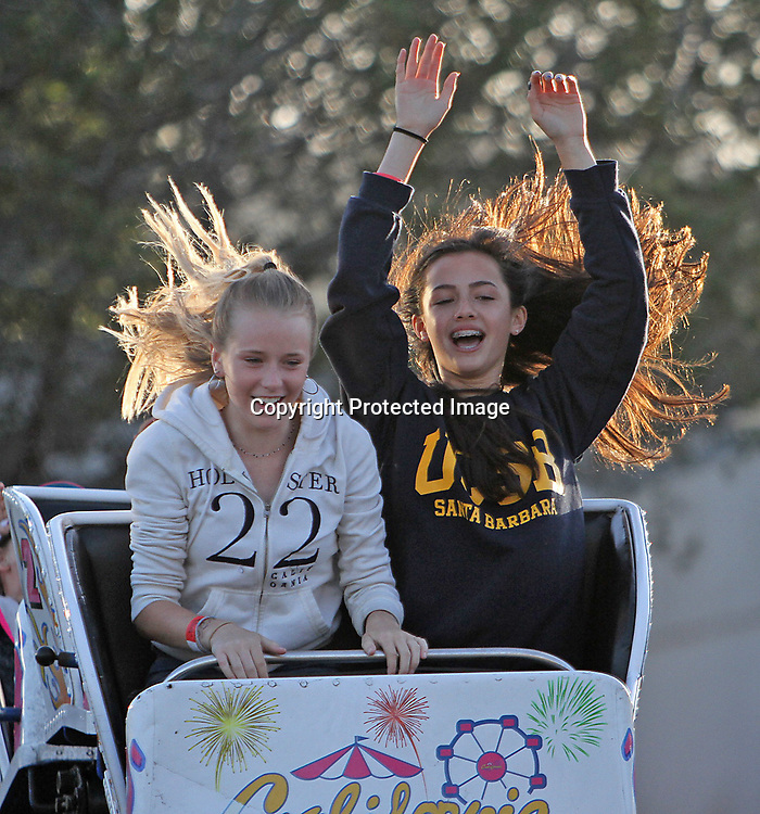 Two young girls enjoy a roller coaster ride during the Mill Valley Memorial Day Carnival